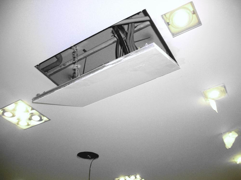 Люк в потолке из гипсокартона можно сделать практически незаметным